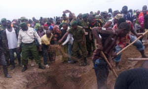 Photo of the burial of Kasereka Matendere Mwana Zaire. A ranger for Virunga National Park who drowned after his boat capsized in Lake Edward. Two others were killed as well.