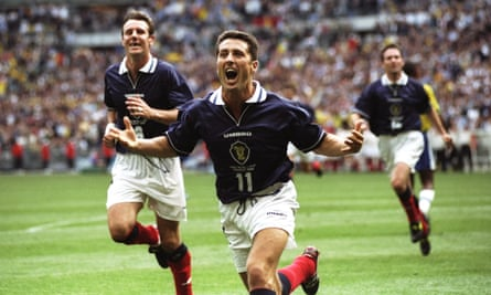 Scotland's John Collins celebrates after scoring from the penalty spot against Brazil in the opening game of the 1998 World Cup at the Stade de France