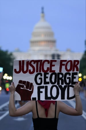 Demonstrators walk along Pennsylvania Avenue as they protest the death of George Floyd, a black man who died in police custody in Minneapolis, Friday, May 29, 2020, in Washington.