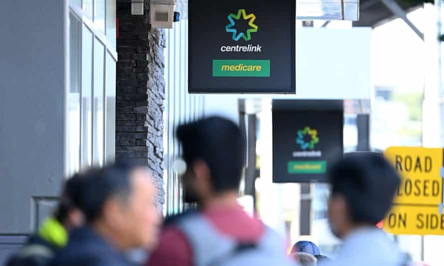 People queue to enter Centrelink on 24 March 2020 in Melbourne, Australia.