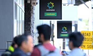 People queue to enter a Centrelink office