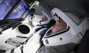 Doug Hurley, foreground, and Bob Behnken work in SpaceX's flight simulator at the Kennedy Space Center in Cape Canaveral, Florida.