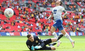 James Norwood of Tranmere looks dejected as his shot goes wide of the Newport goalkeeper Joe Day during the League Two play-off final .