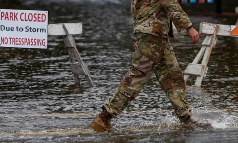 Soldier walks through flood waters