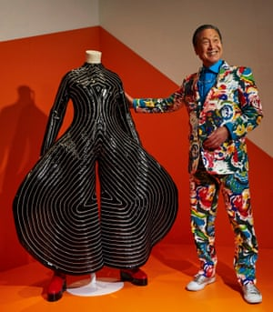 Kansai Yamamoto, with the 'Tokyo Pop' jumpsuit he designed for David Bowie, at a Bowie exhibition in Barcelona, 2017.