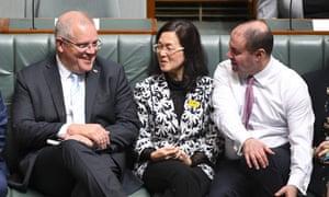 Prime minister Scott Morrison (L) and treasurer Josh Frydenberg (R) sit next to Liberal member for Chisholm Gladys Liu