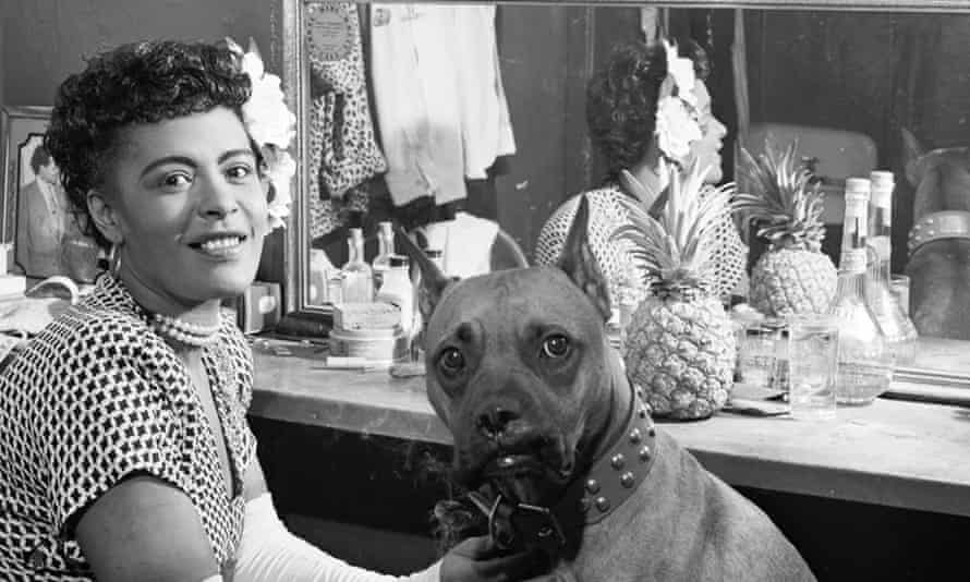 Billie Holiday in 1946, with her dog Mister