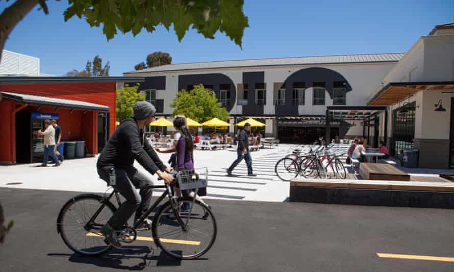 Facebook employees traverse the company's campus.