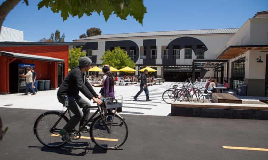 a man cycles past facebook hq in menlo park california