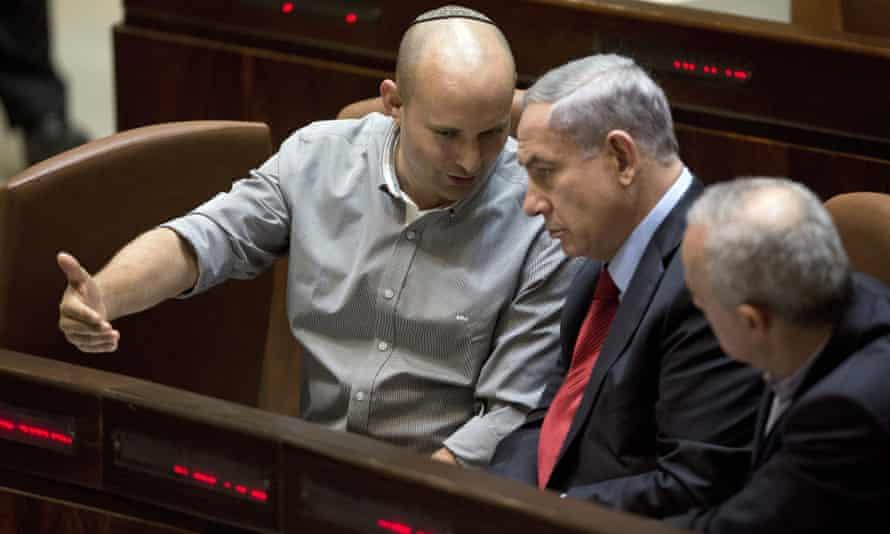 Naftali Bennett and Binyamin Netanyahu attending a voting at the Knesset.