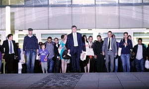 Colin Myler (centre) leads staff and journalists out of the News of the World offices in London after preparing the last edition of the paper on 9 July 2011.