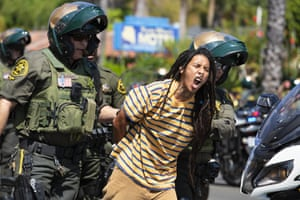 San Clemente, USA Black Lives Matter protester shouts while being arrested as dozens of demonstrators gathered to protest against the fatal shooting of a homeless man by Orange County Sheriff's deputies the previous day in California
