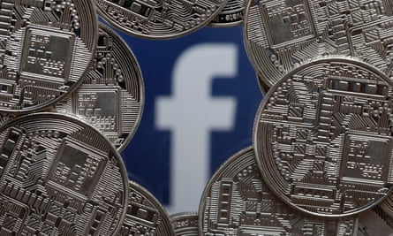 A visual representation of digital cryptocurrency coins sit on display in front of a Facebook logo