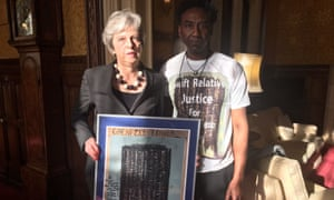 Theresa May with artist Damel Carayol, who lost his niece in the Grenfell Tower fire.