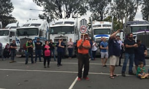 Truckies gathered at a rally protesting the Road Safety Remuneration Tribunal's introduction of minimum pay rates in Canberra, 17 April 2016.