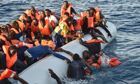 Scenes of panic as people fall in the water during a rescue operation by the Maltese NGO Moas and the Italian Red Cross off the Libyan coast on Thursday.
