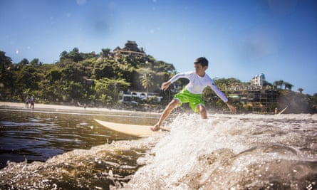 Boy surfing in ocean Sayulita