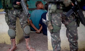 A suspect remains handcuffed after being arrested by Brazilian soldiers, during a joint operation at the Cidade de Deus (City of God) favela in Rio de Janeiro this month.