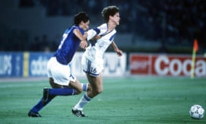 Bruce Murray is held back by Italy's Paolo Maldini as they race for the ball.