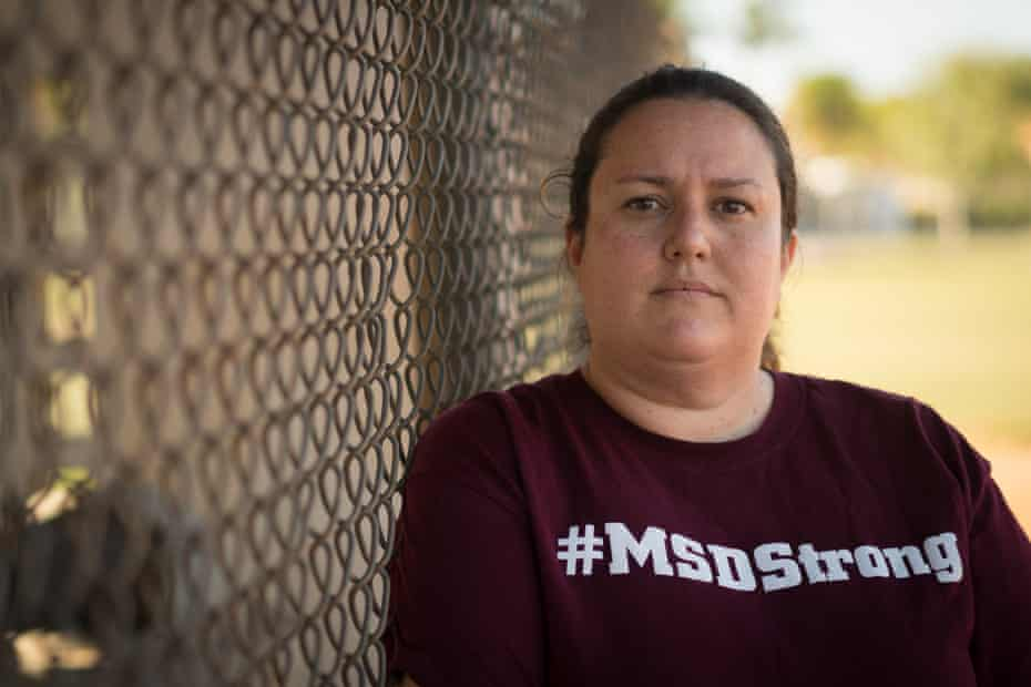 Ashley Kurth, a culinary arts teacher at Marjory Stoneman Douglas high school, opened the door to her classroom to allow more students in.