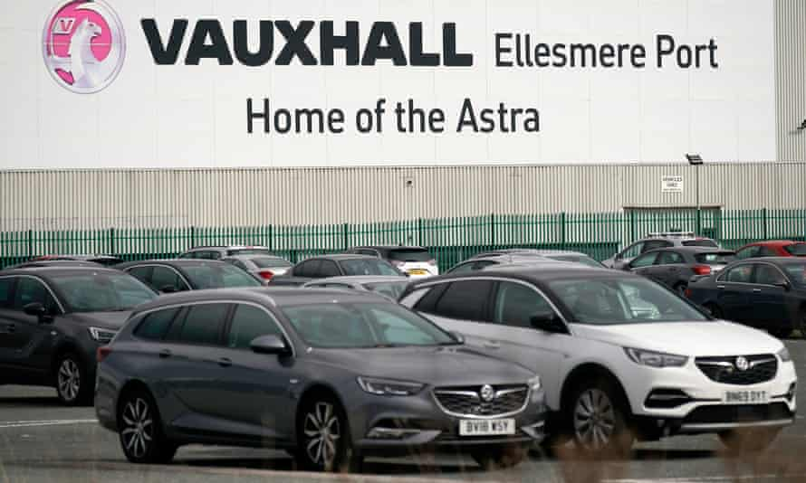 Cars are parked outside the Vauxhall car assembly plant on March 17, 2020 in Ellesmere Port, England