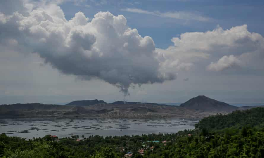 A plume of ash and steam rises from the Taal volcano in Batangas province, the Philippines