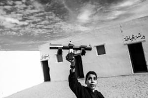 A student from the special education centre in Boujdour camp plays with a Lego plane between classes