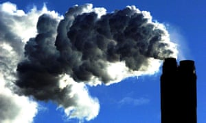 Fumes rise from the chimney of a coal-fired power plant.