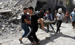 A wounded man is rescued after airstrikes in Aleppo on Wednesday.