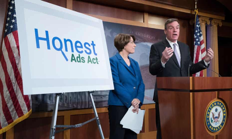 Senators Amy Klobuchar and Mark Warner introduce the Honest Ads Act at a news conference on Capitol Hill on 19 October 2017.