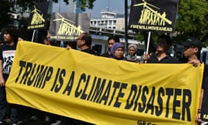 Greenpeace activists during a rally in front of the US embassy in Jakarta on June 7, following President Trump's decision to quit the Paris climate accord.