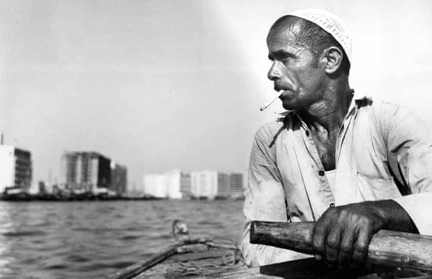 A citizen of Dubai crosses the bay by rowboat