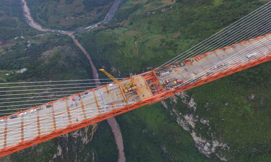 An aerial view shows workers completing the bridge that connects two provinces in Bijie.