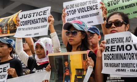 Protesters from Indonesian migrant worker organisations demonstrate outside the court.