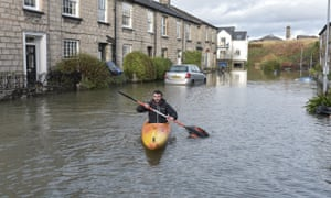 One Kendal residents uses a canoe to access his home.