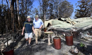 Property owner Stuart Skeen (left) walks with prime minister Scott Morrison through his burnt-out property at Binna Burra in the Gold Coast hinterland.