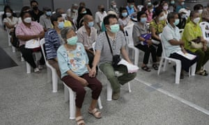 Residents wait for a dose of the AstraZeneca COVID-19 vaccine at the Central Vaccination Center in Bangkok, Thailand. Health authorities said they will seek to put limits on the export of locally produced AstraZeneca vaccine, as the country's supplies of vaccines are falling short of what is needed for its own population.