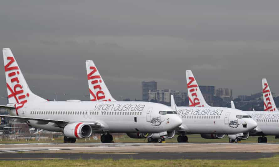Virgin Australia Boeing 737-800 aircraft parked on one of the three runways at Sydney's Kingsford Smith airport. Administrators have received final bids to buy the collapsed airline.