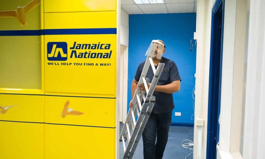 A shop staff member clears out the office of Jamaica National as shopping centre prepares to close its door for the final time.