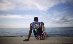 Medical student Electo Rossel, 20, wearing a shirt with a picture of the US president Barack Obama, listens to music at the Malecán seafront outside the US embassy in Havana.