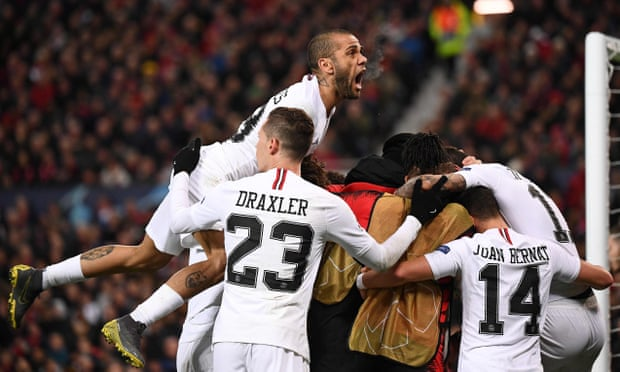 Dani Alves rises highest as PSG players mob Kylian Mbappé after he put their team 2-0 up at Manchester United in their Champions League last-16 1st leg