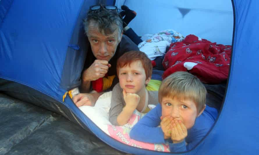 Sam Wollaston and his sons camping in their garden