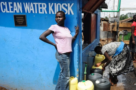 In Kibera slum, as in many Nairobi slums, few houses have toilets or running water; instead local people carry their clean water in jerrycans.