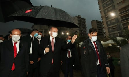 Turkey's president, Recep Tayyip Erdoğan, centre, with the Turkish Cypriot politician Ersin Tatar, left, visit the controversially reopened resort of Varosha.