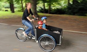 A family cargo bike on the move through the Berlin Zoo district. The bikes are subsidised by some 20 German cities and three states.