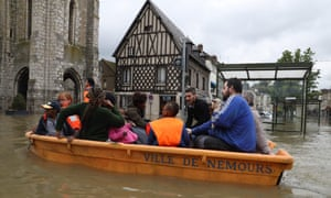 A rescue boat in a flooded street of Nemours, near Paris, France, after downpours in June 2016.