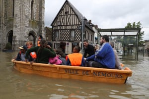 Nemours, France A small boat transports residents in a flooded street