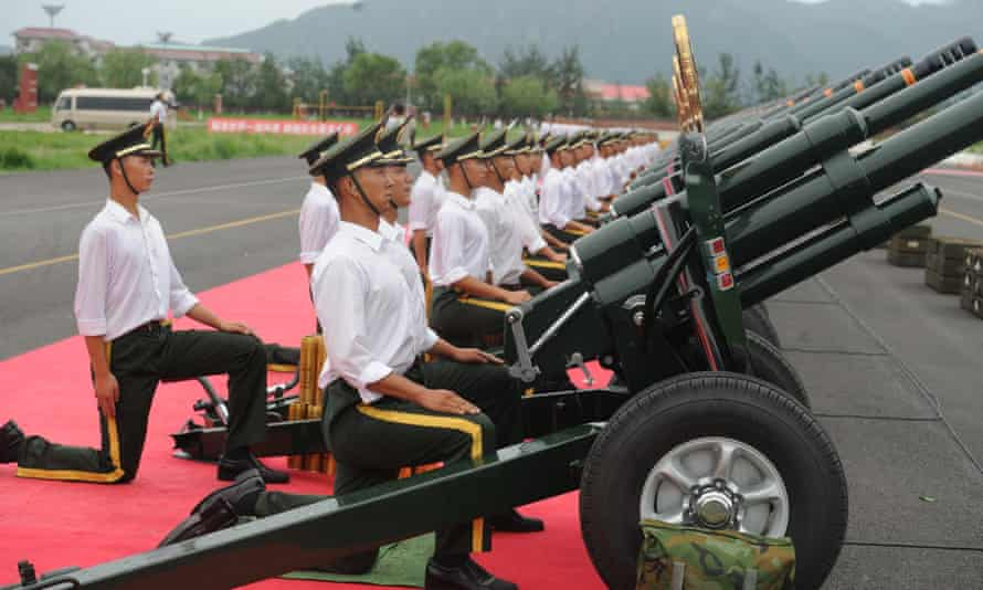 Soldiers of the Beijing armed police force take part in gun salute training for a military parade to be held at Tiananmen Square in Beijing on 3 September.