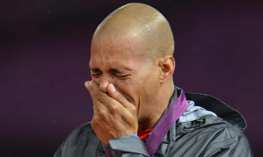 Dominican Republic's gold medalist Felix Sanchez cries on the podium of the men's 400m hurdles at the athletics event of the London 2012 Olympic Games