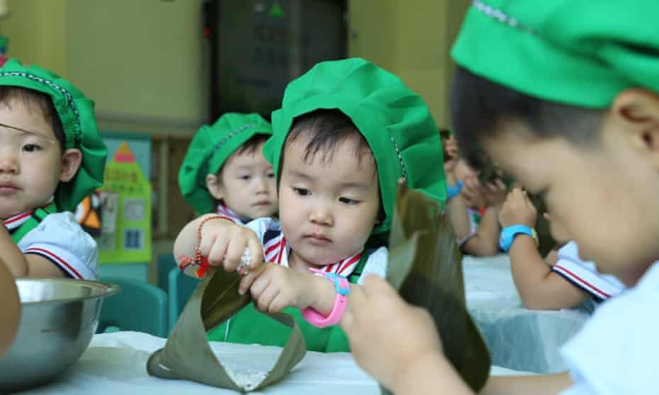 Children make dumplings